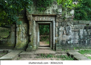 door with bas-reliefs of the royal palace in the archaeological angkor thom place in siam reap cambodia