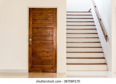 the door beside the stairs
