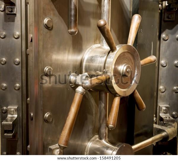 Door of big vintage safe in retail store bank vault security valuable storage