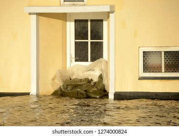 A door blocked with sandbags, due to a storm surge.
