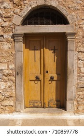 The door of the church. Fortress of the island of Spinalonga. Leprosarium. Crete, Greece.