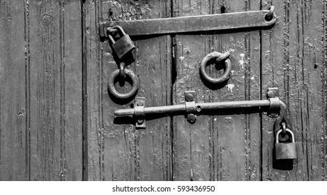 Door deadbolt. Old gate closed on the lock and deadbolt