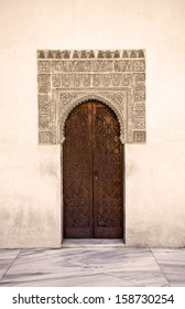 Door decorated in arabic style in The Alhambra in Granada, Andalusia, Spain