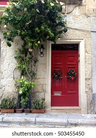 A door decorated with Christmas wreath in Malta