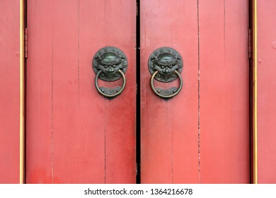 Door detail with brass lion door knockers close up, Buddha Tooth Relic Temple, Chinatown, Singapore, Asia. It is Chinese style architecture of temple that popular attraction in China town of Singapore
