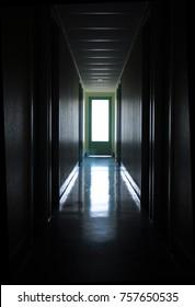 Door at the end of a dark hallway. Closed door in the hallway. Door to another world