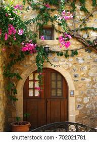 Door, flowers stone wall at Monemvasia, Peloponese, Greece