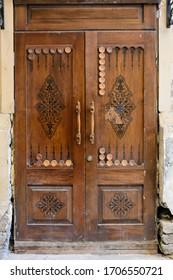 A door in a form of a backgammon (nard) board in Old Town of Baku, Azerbaijan