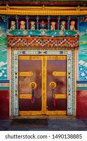 Door gate in Buddhist monastery. Mud village, Pin Valley, Himachal Pradesh, India