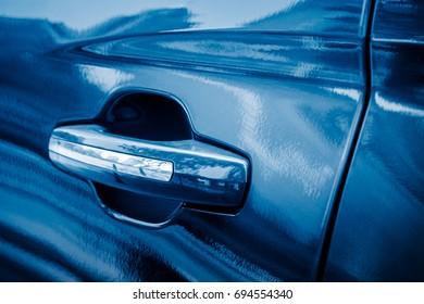 Door handle of automobile,closeup,blue toned.