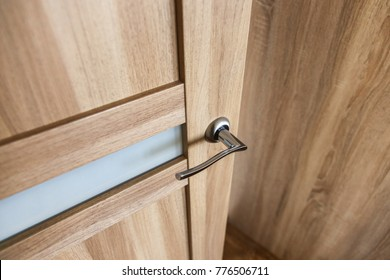 Door Handle In The Interior. Knob Close Up Elements. Open And Closed Light