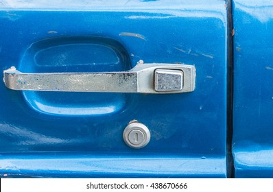 Door handle of old blue car , with abrasion on classic car