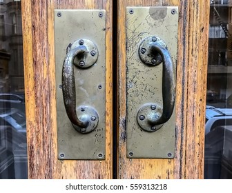 Door handles on the entrance to a private residence.