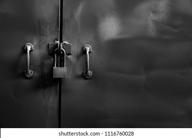 The door has a lock key white and black background .