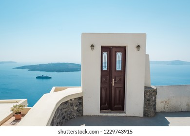 Door to the heaven. Cozy streets of Santorini. View over Mediterranean Sea at warm sunny summer day.