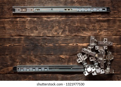 Door hinges on a wooden table background with copy space. Furniture maker table.