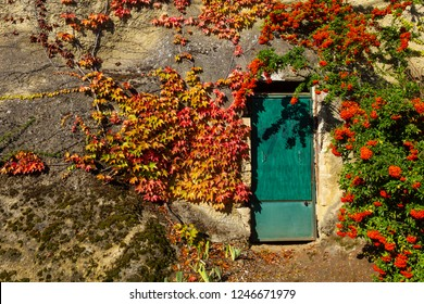 Door of a house in a rock at Auvers-sur-Oise village, France