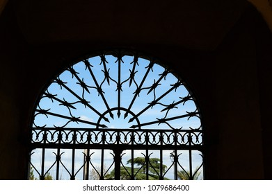 Door with iron gate in san Pietro in montorio