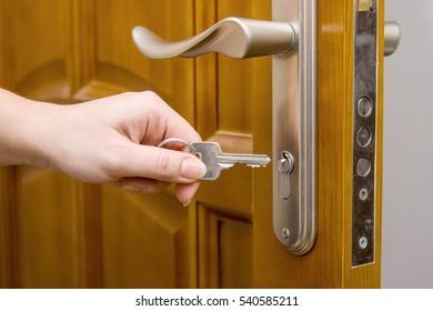Door, key and hand