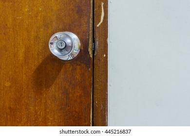 Door Knob on Wood Door beside white background