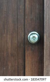 Door knob on wooden door