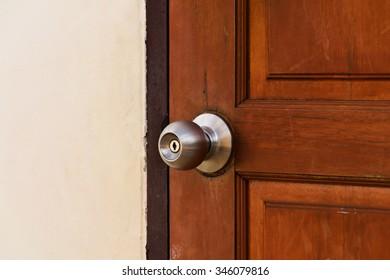 Door knob with wooden door