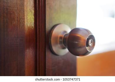 door knob with wooden door background