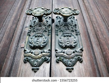 Door knobs of an old door.  Eye of Providence, the all-seeing eye is the symbol of a single eye encompassed by a triangle, often surrounded by shining rays of light.