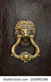 Door knocker close-up on a wooden wall