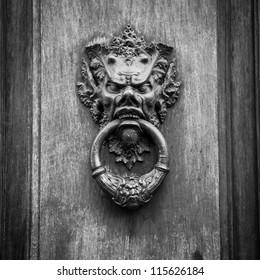 Door knoker on an old wodden door in Tuscany - Italy