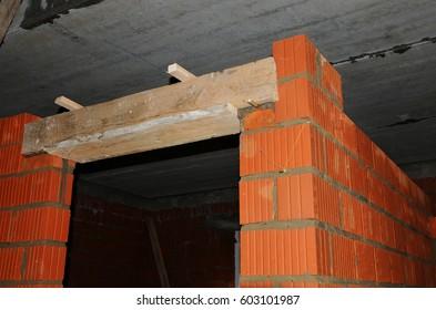 Door Lintel. Building House Construction. Door Concrete Lintel With  Unfinished House Construction.