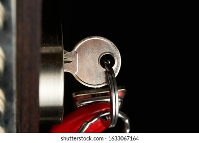 the door lock with the handle and a key. - Shutterstock ID 1633067164