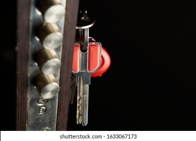 the door lock with the handle and a key. Focus on keys. - Shutterstock ID 1633067173