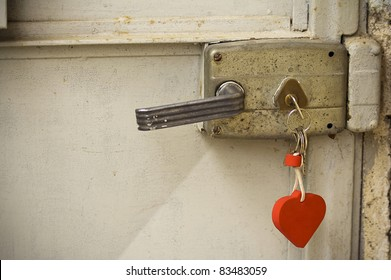 Door lock with a heart shaped key-ring