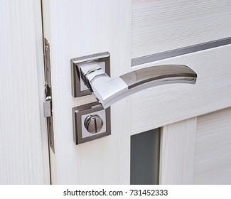 the door lock in the room, door latch, Close-up of repairing door, professional locksmith installing or repairing a new deadbolt lock on a house