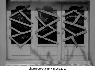 The door was locked shut with a piece of wood covered, black and white tone