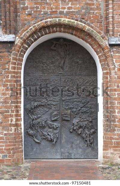 Door made of bronze. Shot from the St. Georgen Church in Wismar, Germany