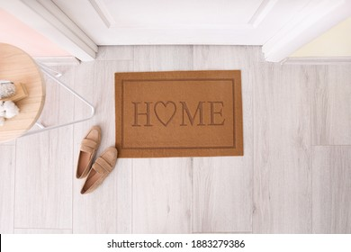 Door mat with shoes in hallway