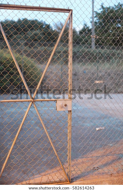 door in the metal net fence