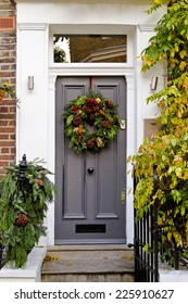 Door with natural wreath decoration for Christmas holiday