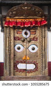 Door in the Nepalese temple executed in nevara style, with the image of the angry deity with three eyes.