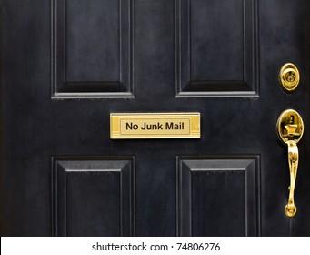 Door with a NO JUNK mail slot