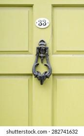 Door number 33 thirty three knocker with cobwebs closeup