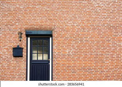 Door on brick wall, side of a house