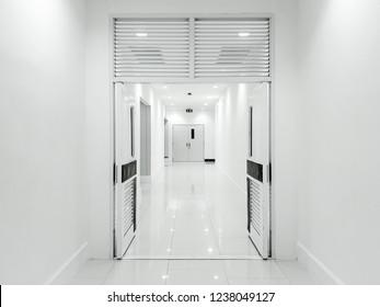 The door opened and empty corridor with white tone