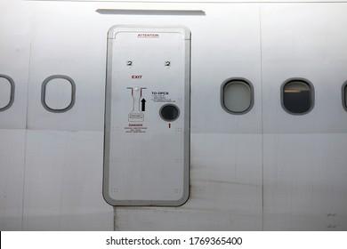 Door of the passenger jet airplane in airport. Close view. This image was taken Tehran, Iran - Circa September 26, 2011