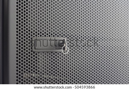 Door Perforated Of Server Rack Cabinet. The Key Is Inserted Into The Door  Lock.