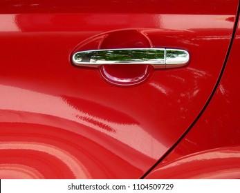 door of red car