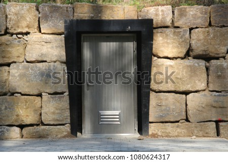 Door in a sandstonebuilding in the Woods