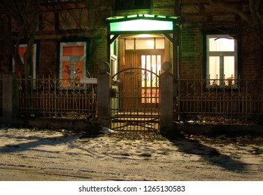 door of a scenic vintage house with framework in the village Gollau, Wendland, Germany during a winter evening with snow